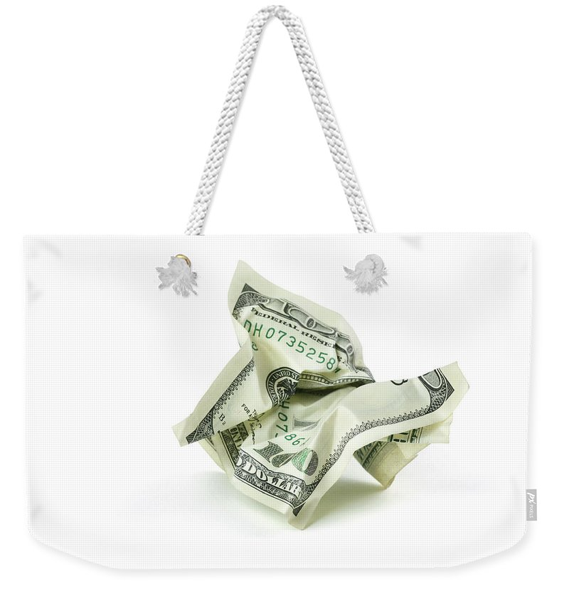 Debt Weekender Tote Bag featuring the photograph Crumpled Money With Clipping Path by Georgepeters