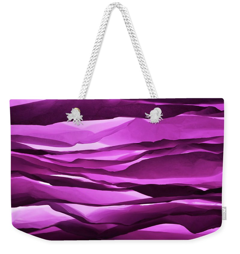 Purple Weekender Tote Bag featuring the photograph Crumpled Sheets Of Purple Paper by Ballyscanlon
