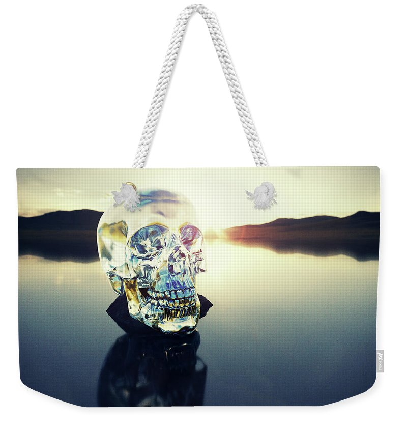Art Weekender Tote Bag featuring the photograph Crystal Skull Laying On Rock In Lake by Doug Armand
