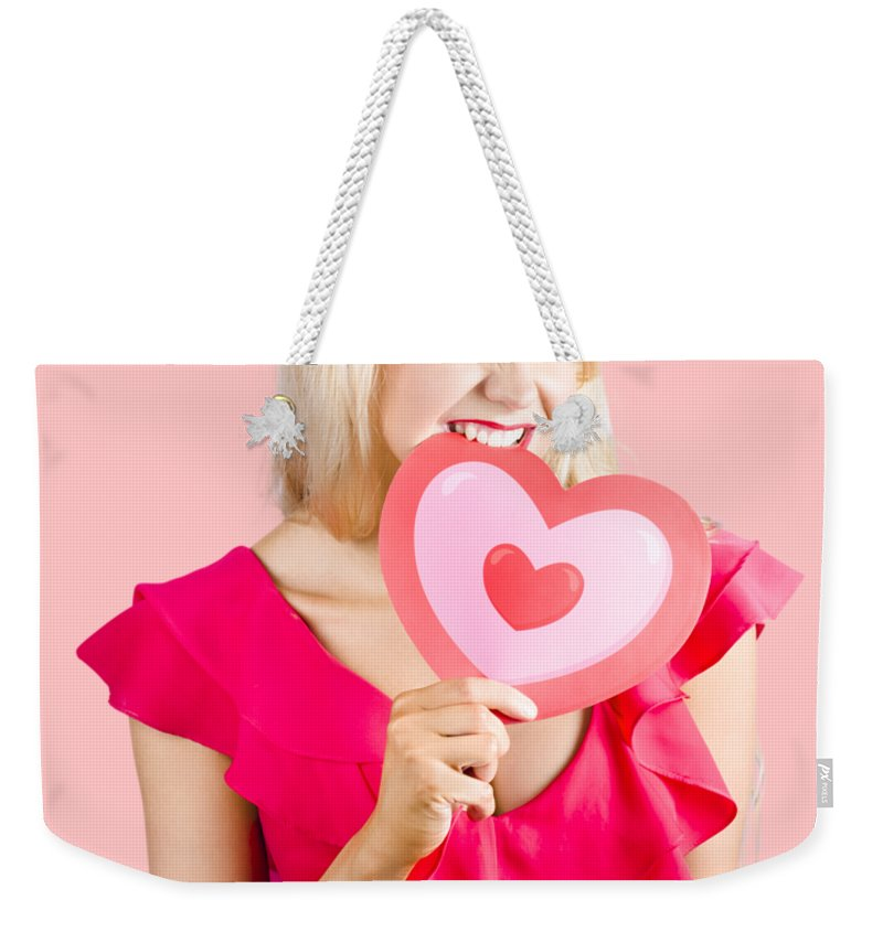 Heart Weekender Tote Bag featuring the photograph Cute Woman Biting Big Red Love Heart by Jorgo Photography - Wall Art Gallery