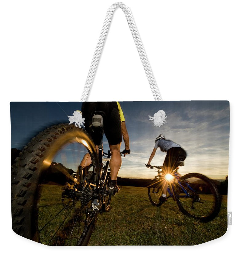 Blurred Motion Weekender Tote Bag featuring the photograph Cycling Adventure by Gorfer