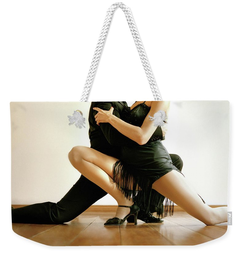 Heterosexual Couple Weekender Tote Bag featuring the photograph Dancers In Tango Position, Low Section by David Sacks