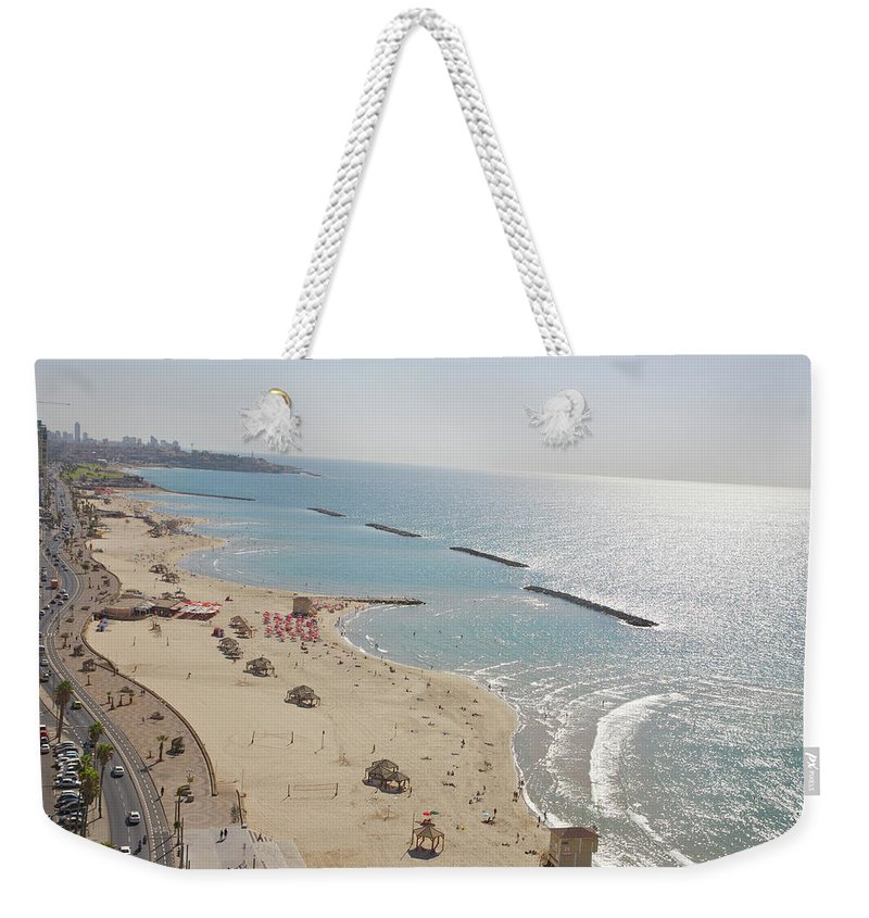 Tranquility Weekender Tote Bag featuring the photograph Day View Of Tel Aviv Promenade And Beach by Barry Winiker