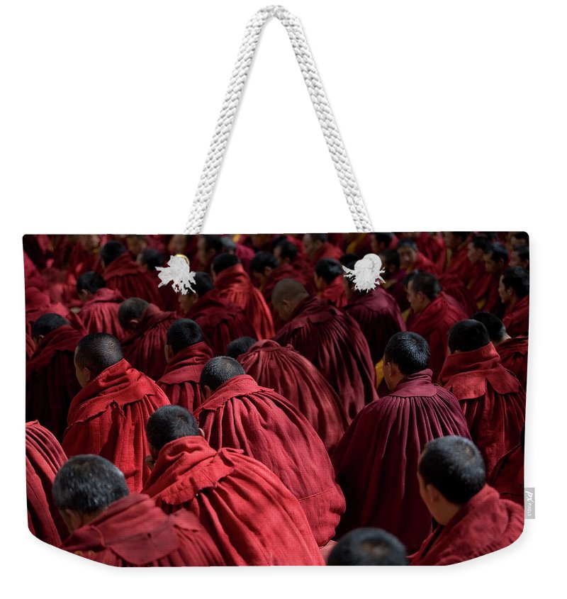 Punishment Weekender Tote Bag featuring the photograph Debating Monks by Caval