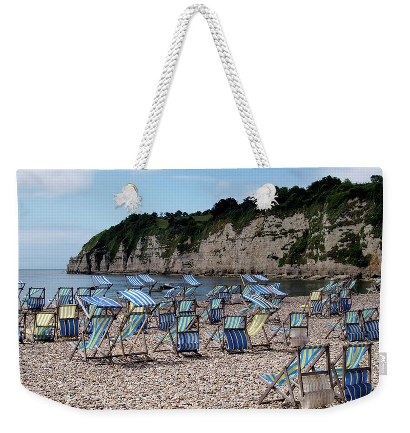 Tranquility Weekender Tote Bag featuring the photograph Deckchairs At Beer, Devon, Uk 2013 by Nik Taylor
