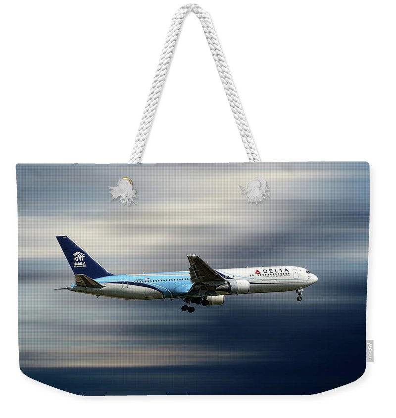 Delta Weekender Tote Bag featuring the mixed media Delta Air Lines Boeing 767-332 by Smart Aviation