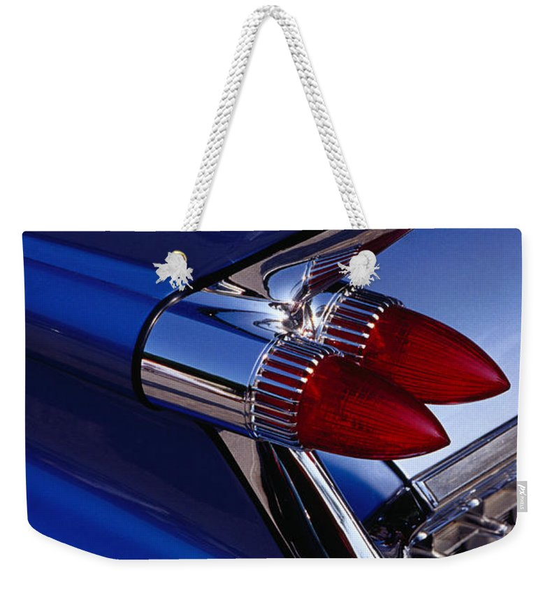 Silver Colored Weekender Tote Bag featuring the photograph Detail Of An American Cadillac, Eze by Richard I'anson