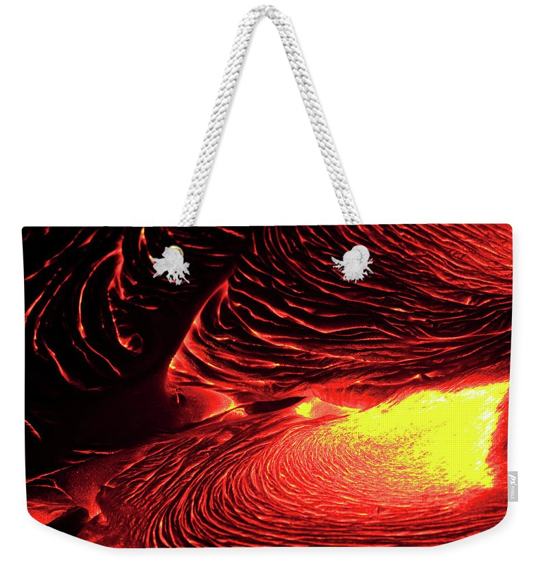 Hawaii Volcanoes National Park Weekender Tote Bag featuring the photograph Detail Of Flowing Lava, Hawaii by Mint Images/ Art Wolfe