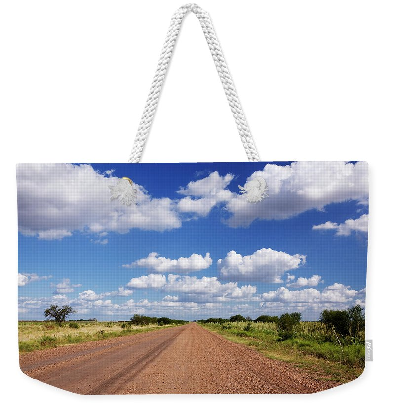 Latin America Weekender Tote Bag featuring the photograph Dirt Road And Puffy Clouds by Jeremy Woodhouse