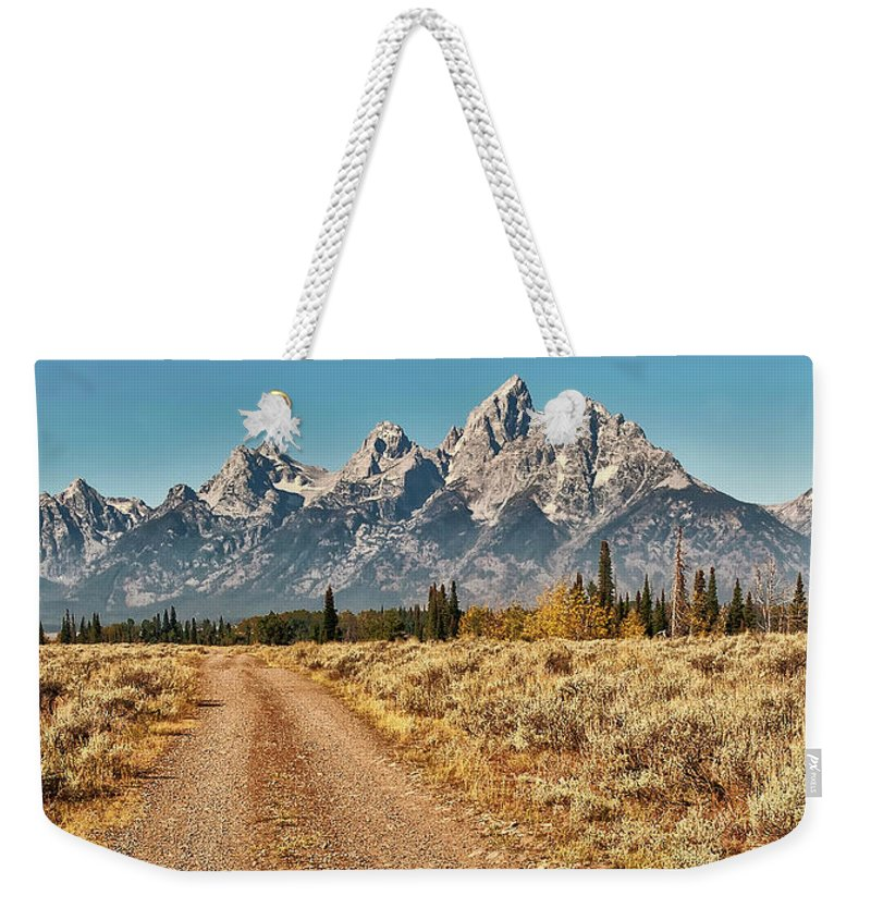 Tranquility Weekender Tote Bag featuring the photograph Dirt Road To Tetons by Jeff R Clow