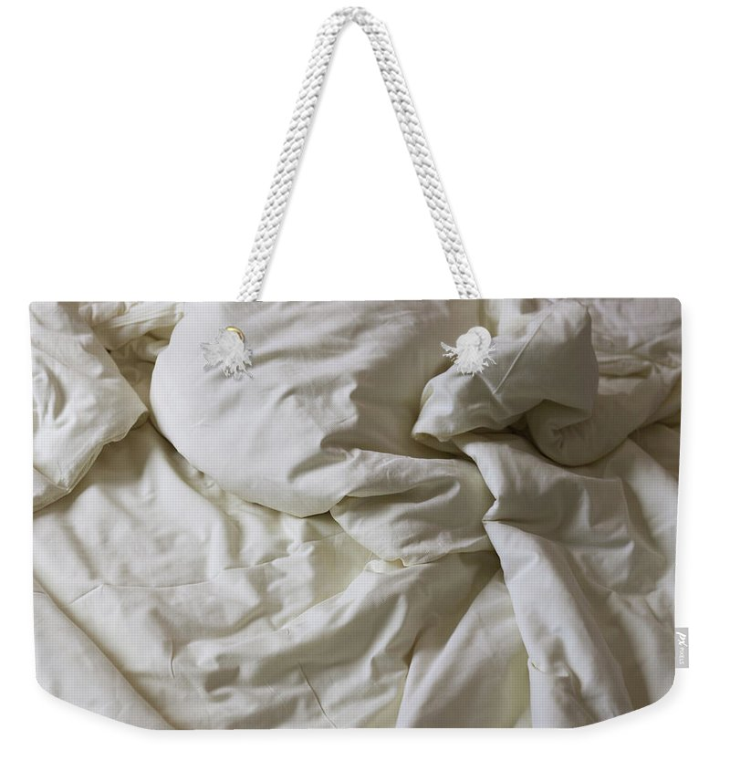 Hotel Weekender Tote Bag featuring the photograph Discarded Bed, Early Morning by Julio Lopez Saguar