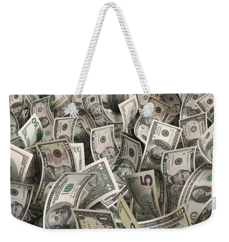 Five Dollar Bill Weekender Tote Bag featuring the photograph Dollars by Ktsfotos