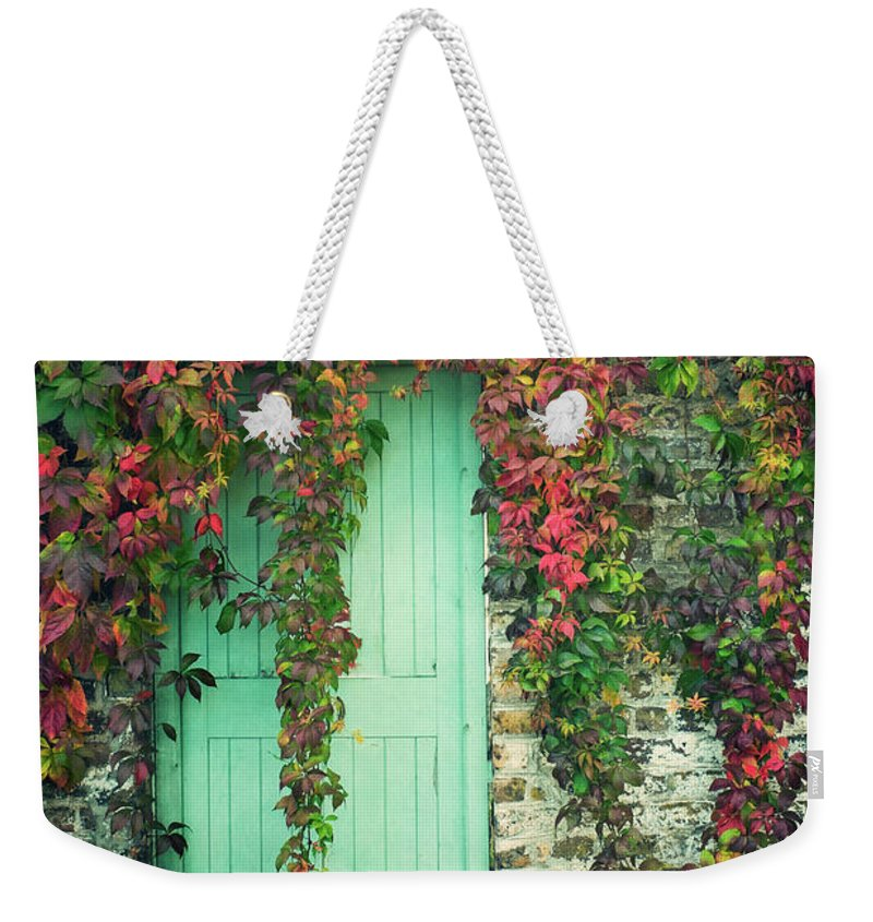 Tranquility Weekender Tote Bag featuring the photograph Door To The Secret Garden by Image By Catherine Macbride