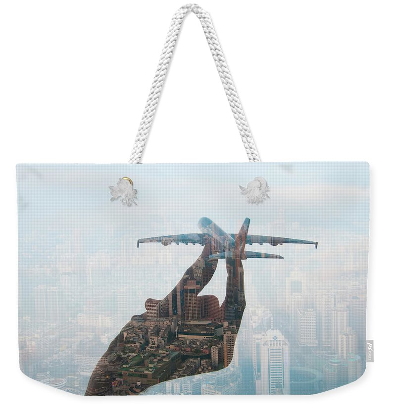People Weekender Tote Bag featuring the photograph Double Exposure Of Hand Holding Model by Jasper James