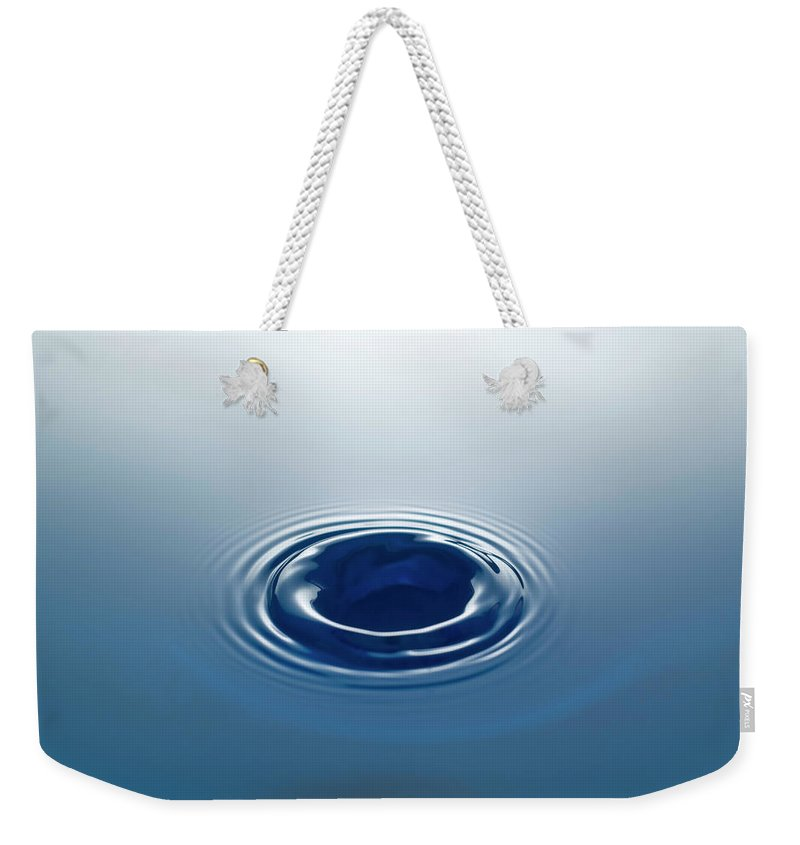 Motion Weekender Tote Bag featuring the photograph Drop by Stockcam