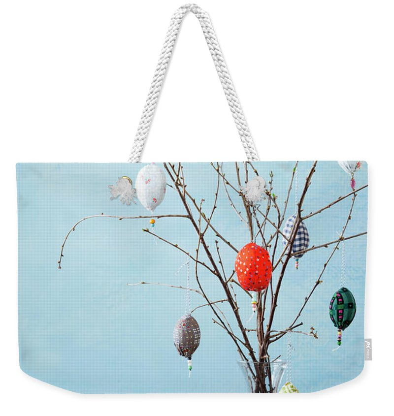 Holiday Weekender Tote Bag featuring the photograph Egg-shaped Decorations On Branches by Stefanie Grewel