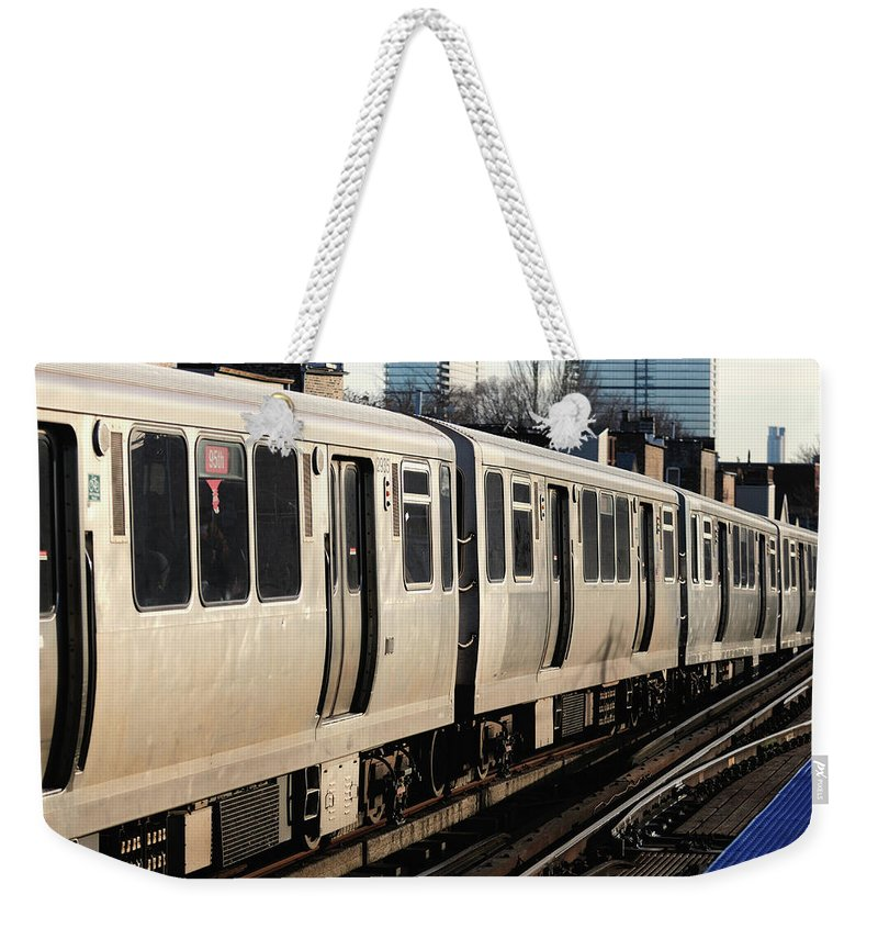 Railroad Track Weekender Tote Bag featuring the photograph Elevated Train Descends Into Subway by Bruce Leighty