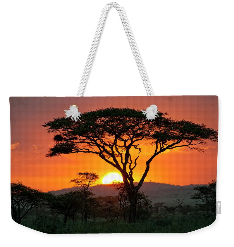 Scenics Weekender Tote Bag featuring the photograph End Of A Safari-day In The Serengeti by Guenterguni