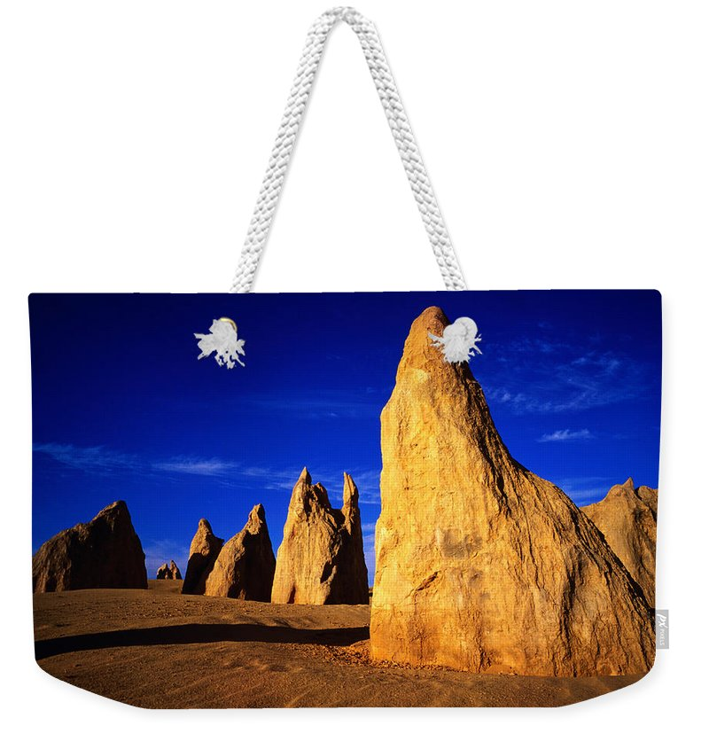 Toughness Weekender Tote Bag featuring the photograph Eroded Rock Formations, Pinnacles by John Banagan