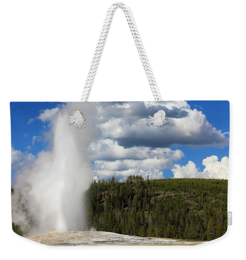 Geyser Weekender Tote Bag featuring the photograph Eruption Of Old Faithful Geyser In by Pawel.gaul