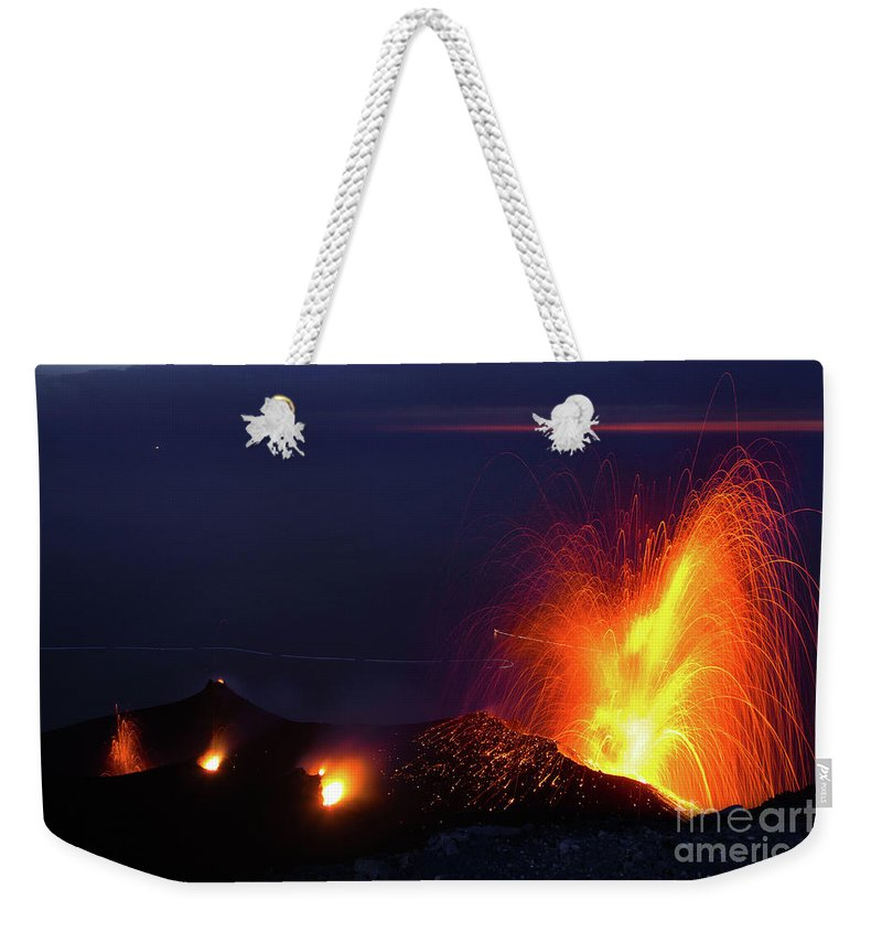 Non-urban Scene Weekender Tote Bag featuring the photograph Eruption Of Stromboli Volcano, Italy by Francesco Sartori