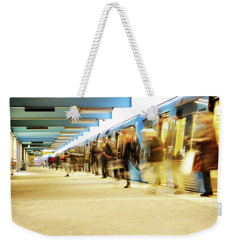 Crowd Weekender Tote Bag featuring the photograph Exiting Subway Train by Olaser