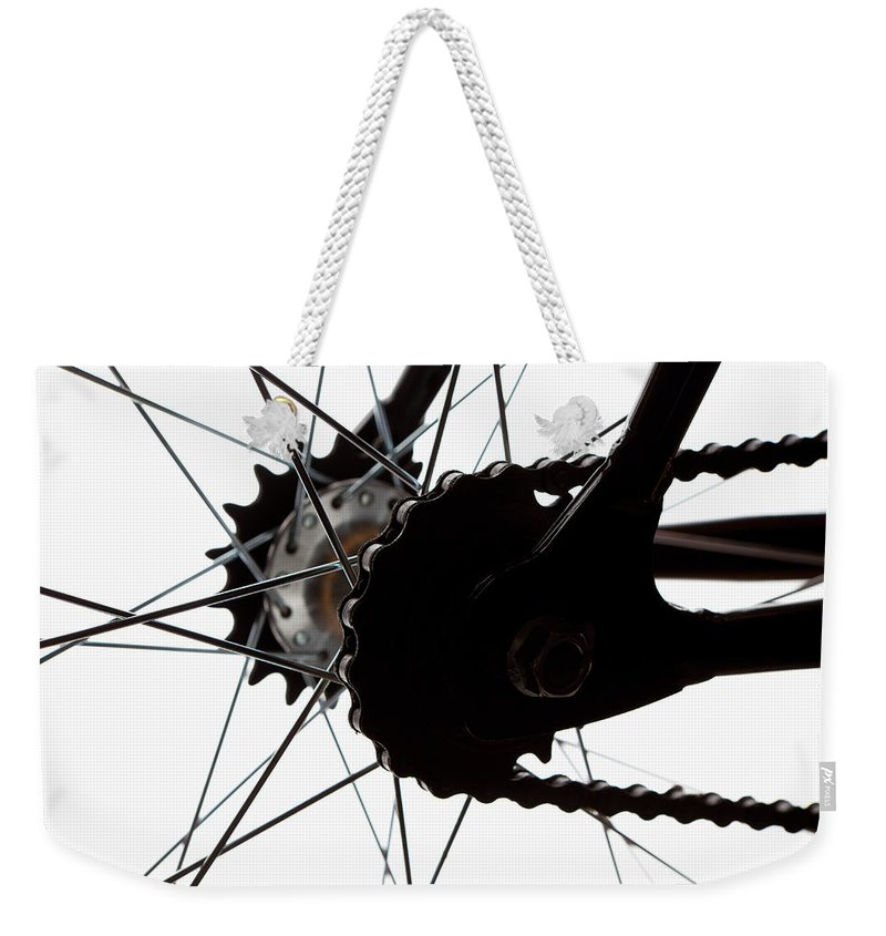 White Background Weekender Tote Bag featuring the photograph Extreme Close Up Of Chain And Spokes by Epoxydude