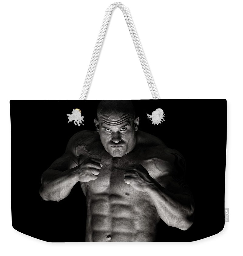 Toughness Weekender Tote Bag featuring the photograph Extreme Guy by Vuk8691