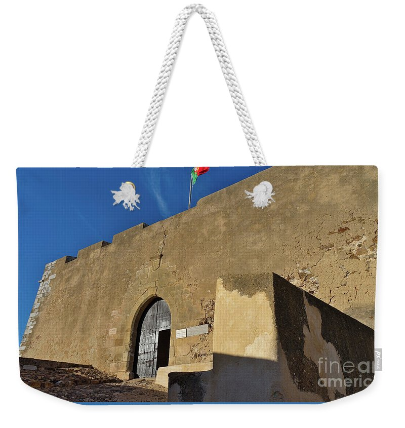 Castro Marim Weekender Tote Bag featuring the photograph Facade Of The Medieval Castle Of Castro Marim by Angelo DeVal