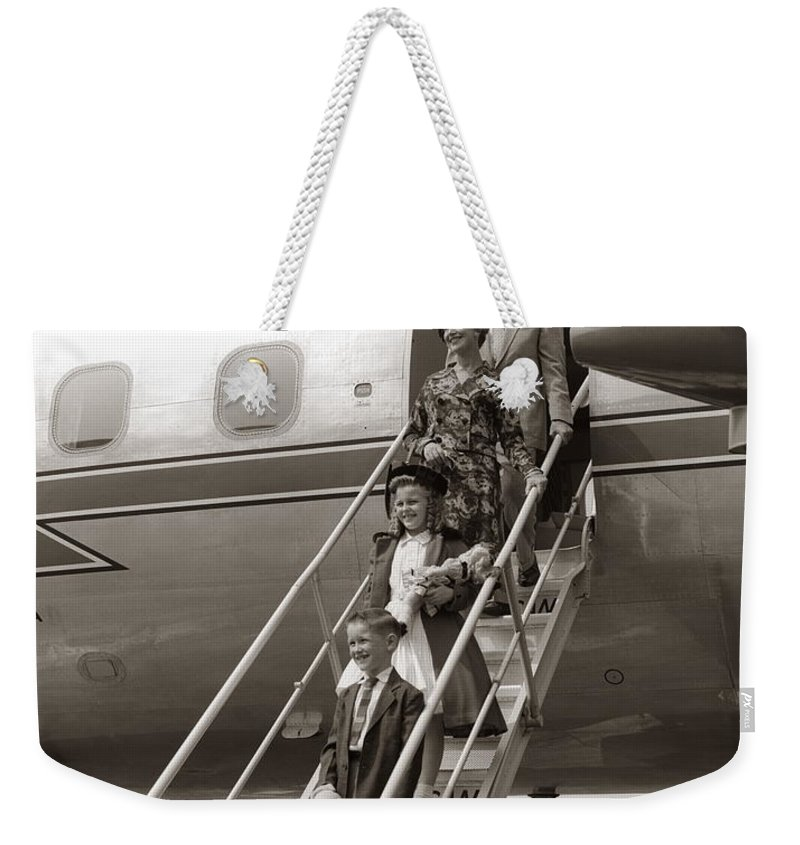 Steps Weekender Tote Bag featuring the photograph Family Walking Down Airplane Stairs by H. Armstrong Roberts
