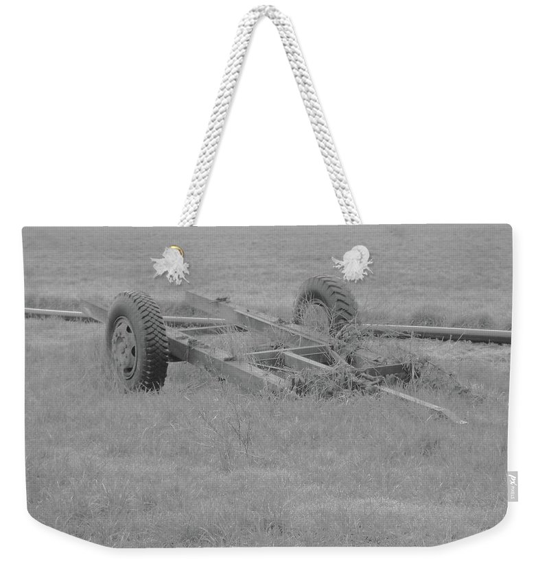 Weekender Tote Bag featuring the photograph Farm Equipment by James Harris