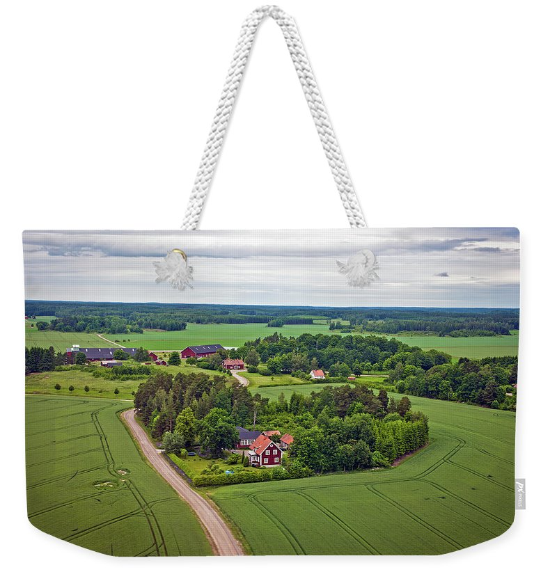 Scenics Weekender Tote Bag featuring the photograph Farms And Fields In Sweden North Europe by Pavliha