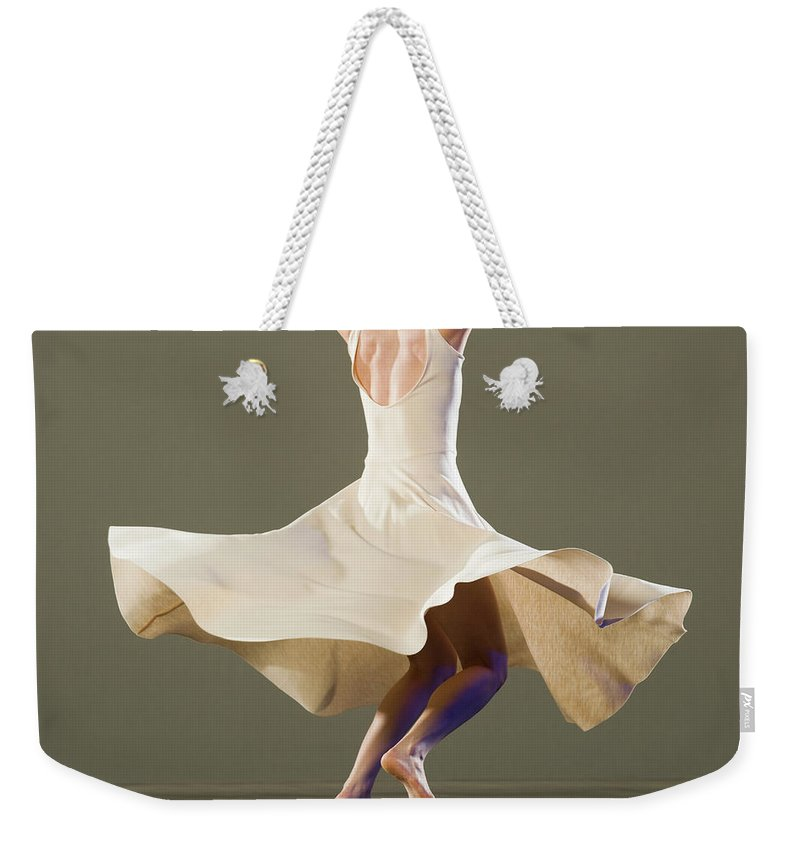 Ballet Dancer Weekender Tote Bag featuring the photograph Female Ballet Dancer Dancing by Erik Isakson