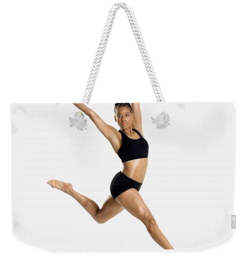 Ballet Dancer Weekender Tote Bag featuring the photograph Female Dancer Jumping by Image Source