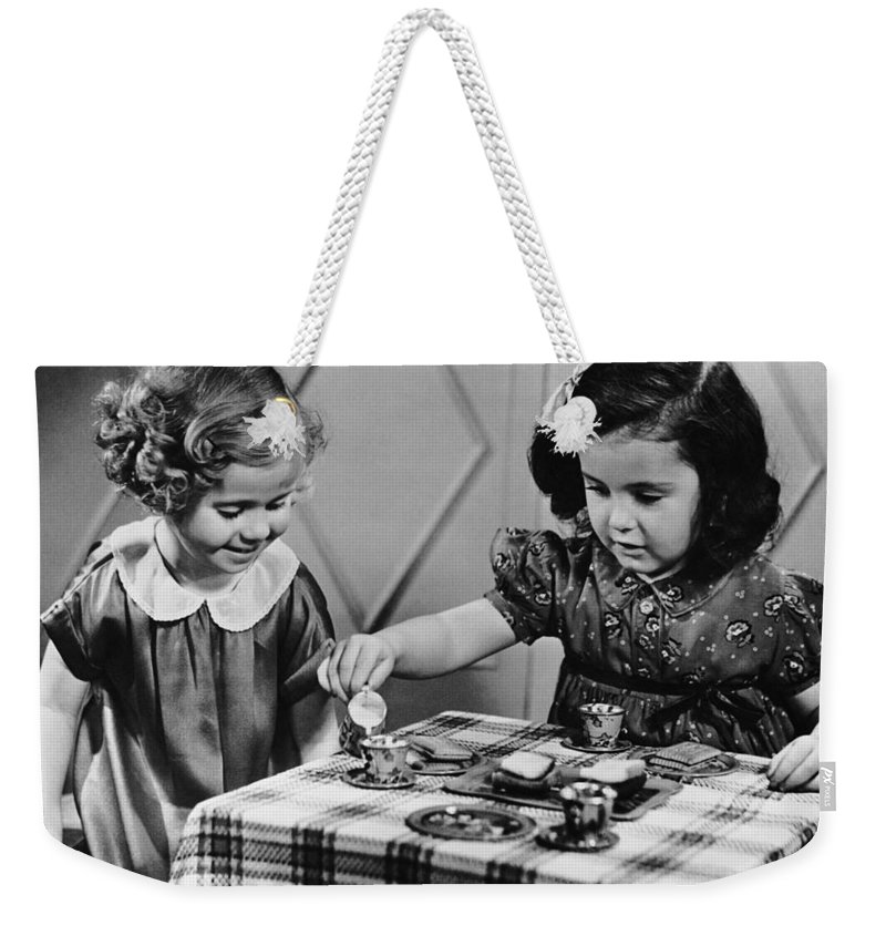 Sibling Weekender Tote Bag featuring the photograph Female Siblings Having A Tea Party by George Marks