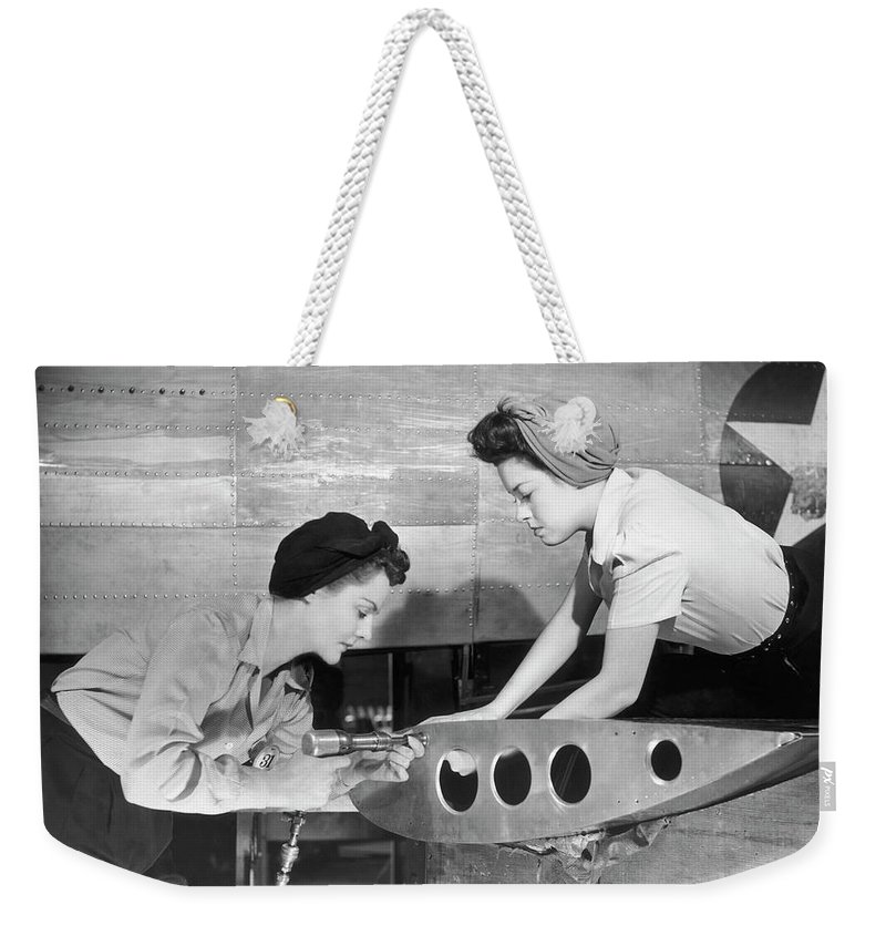 Working Weekender Tote Bag featuring the photograph Female Workers Working On Plane by George Marks