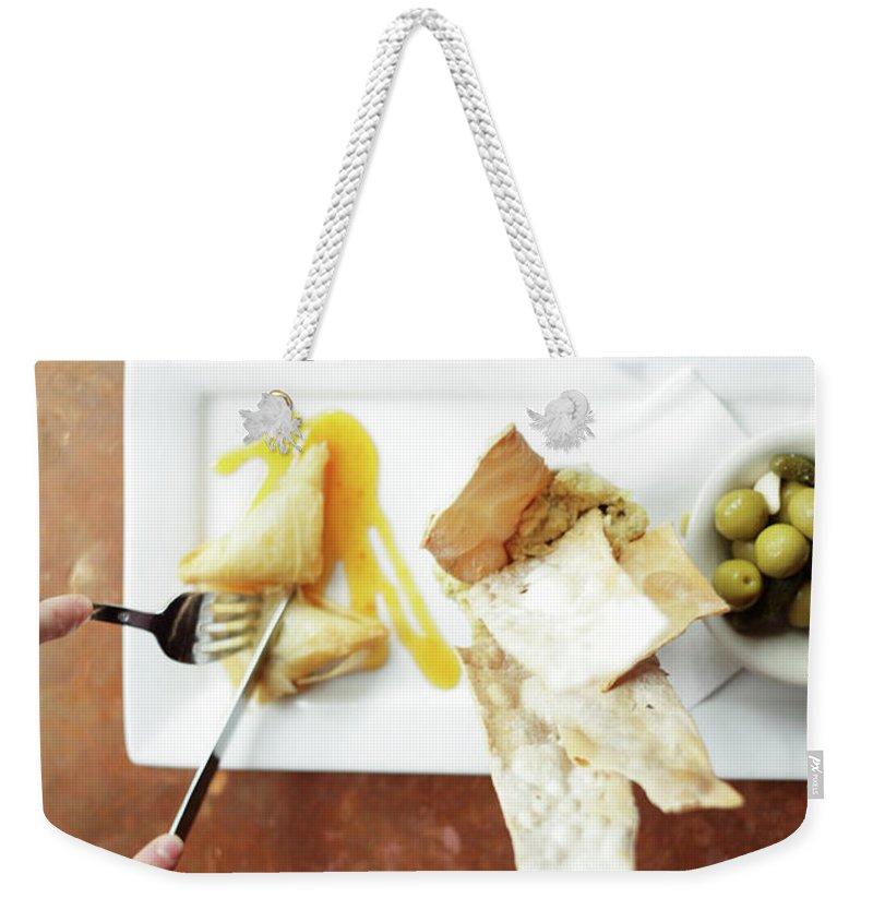 Feta Cheese Weekender Tote Bag featuring the photograph Feta Crisps by Caleb Condit