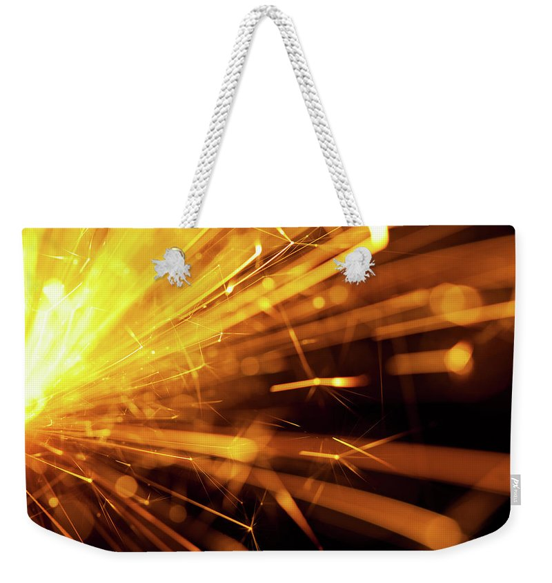 Funky Weekender Tote Bag featuring the photograph Fire Sparkler by Nikada