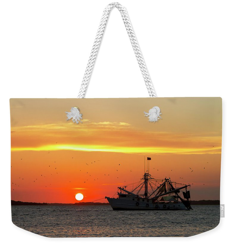 Water's Edge Weekender Tote Bag featuring the photograph Fishing Boat At Sunset by Tshortell