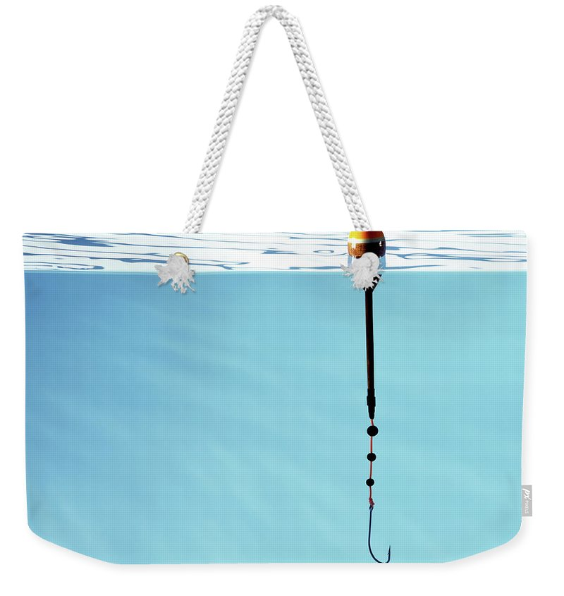 Temptation Weekender Tote Bag featuring the photograph Fishing Hook And Float, Hook Under Water by Pier