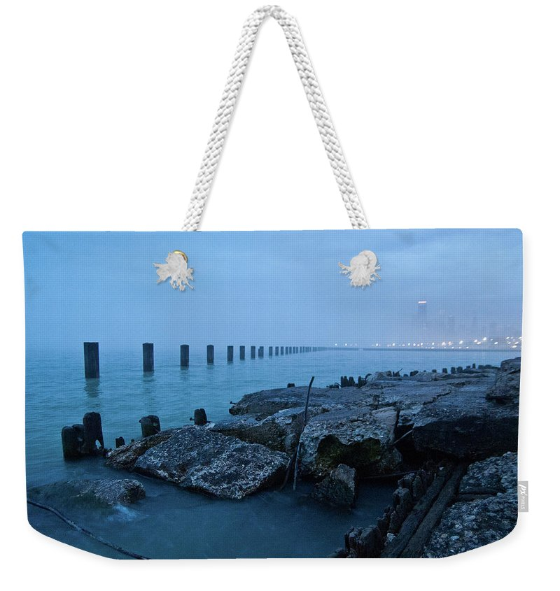 Lake Michigan Weekender Tote Bag featuring the photograph Foggy View Of Chicago From Lakeshore by Megan Ahrens