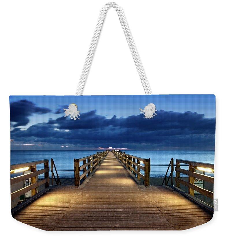 Water's Edge Weekender Tote Bag featuring the photograph Footbridge by Bertlmann