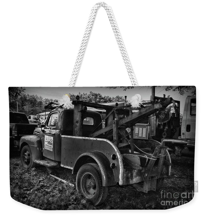 Paul Ward Weekender Tote Bag featuring the photograph Ford F4 Tow The Truck Business End Black And White by Paul Ward