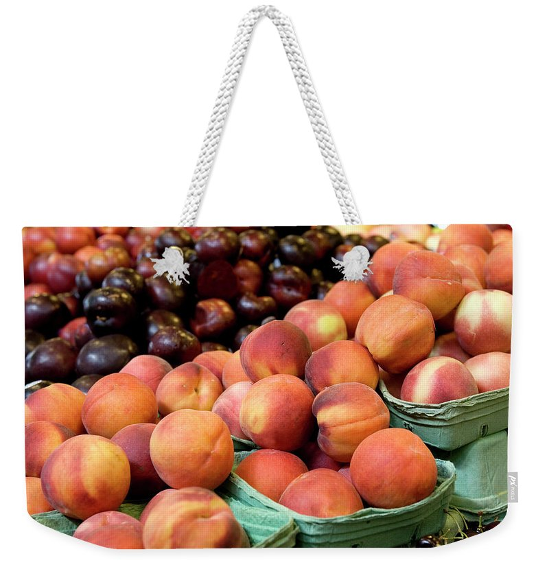 Cherry Weekender Tote Bag featuring the photograph Fresh Peaches At Organic Market by Lillisphotography