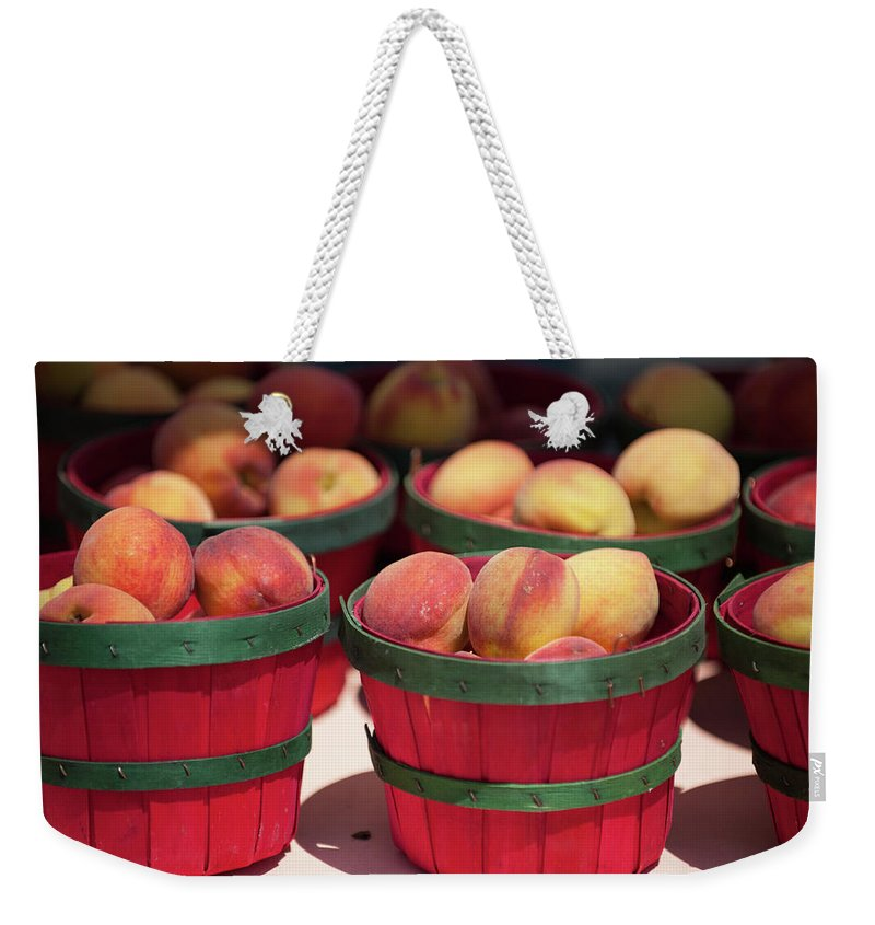 Retail Weekender Tote Bag featuring the photograph Fresh Texas Peaches In Colorful Baskets by Txphotoblog - Randy Ennis