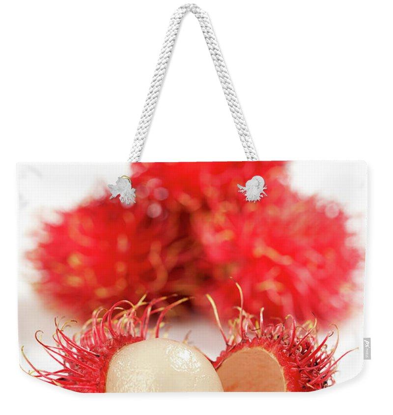 Raw Food Diet Weekender Tote Bag featuring the photograph Fresh Thai Rambutans by Enviromantic