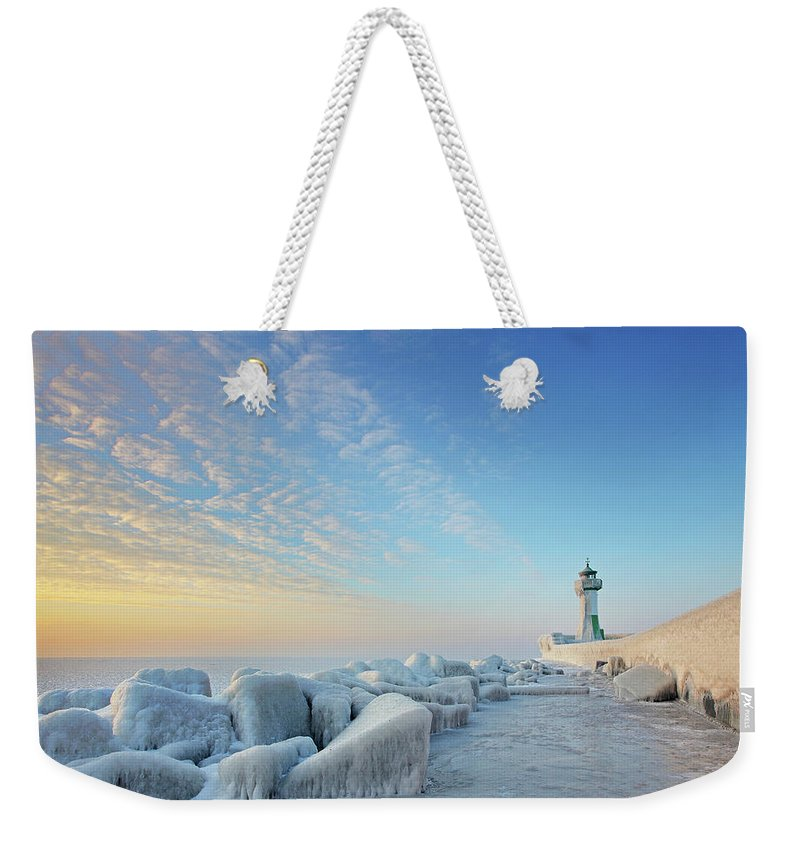 Dawn Weekender Tote Bag featuring the photograph Frozen Lighthouse by Sandra Kreuzinger