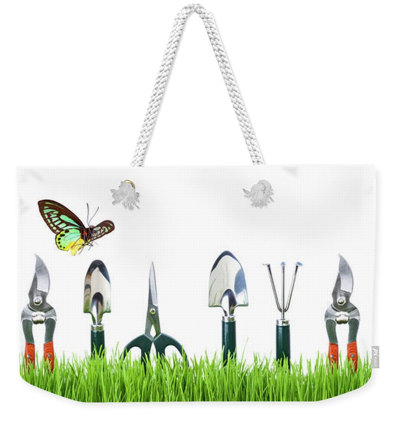 Grass Weekender Tote Bag featuring the photograph Garden Tools by Liliboas