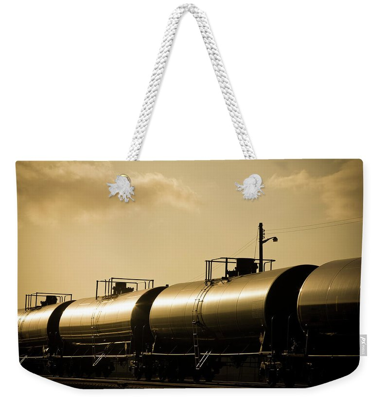 Natural Gas Weekender Tote Bag featuring the photograph Gasoline Train At Sunset by Halbergman