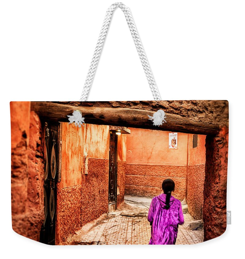Child Weekender Tote Bag featuring the photograph Girl In Marrakech by Nature And Beauty Photographer